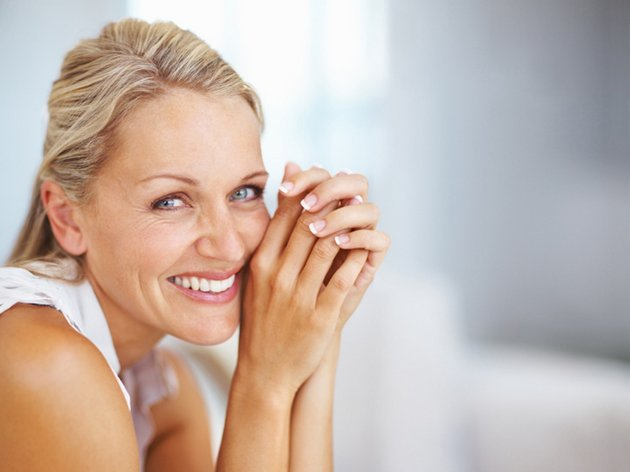 Portrait of a happy aged woman, smiling