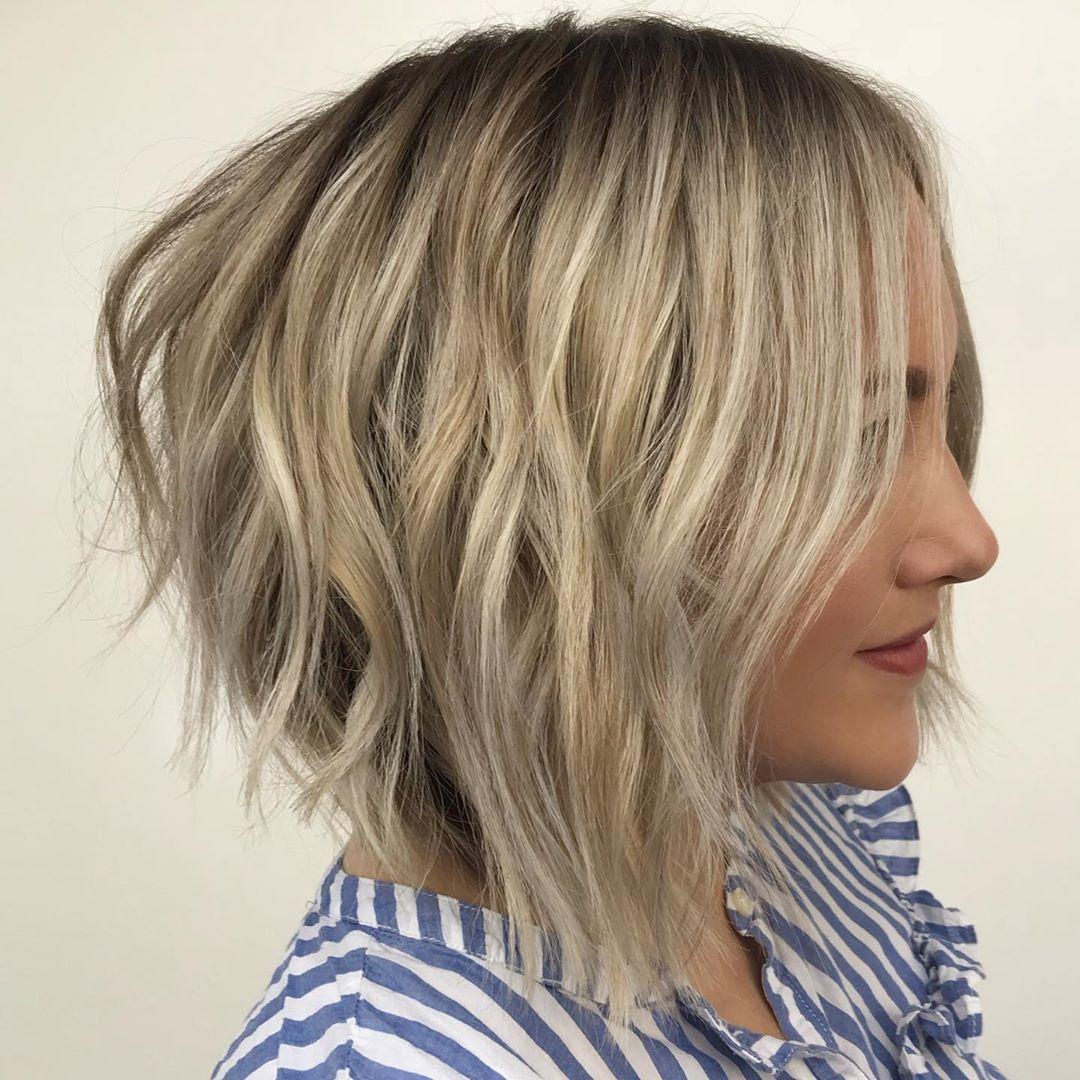 Укладка на короткие волосы с объемом фото 5