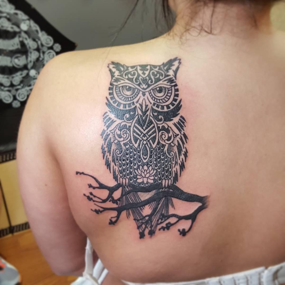 Татуировки с изображением совы фото 7