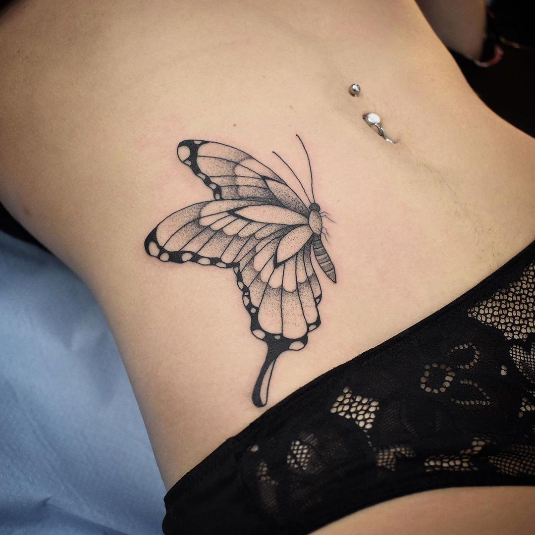 татуировки в виде бабочек фото 21