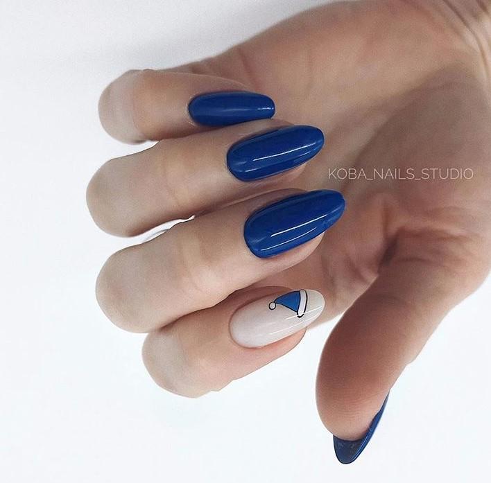синий новогодний маникюр фото 7